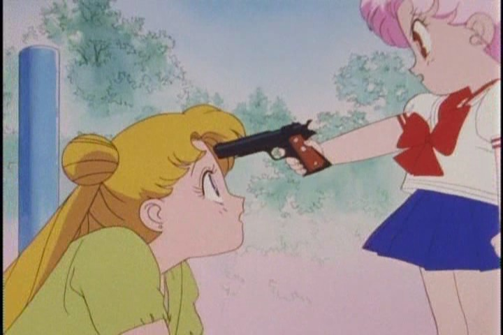 Chibi-Usa holds a gun to Usagi's head