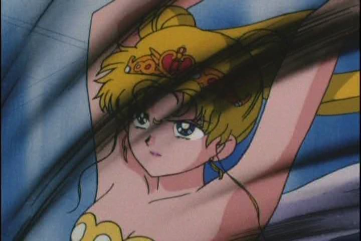 I LOVE this shot. Sailor Moon often looks cross, but she's never looked THIS pissed off before. Those eyes are amazing